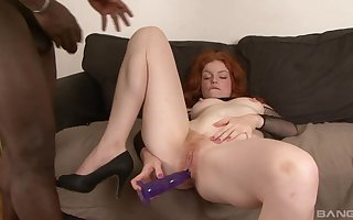 Hot redhead gets efficacious yon a BBC together with she loves tingle