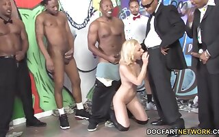 Several black men fuck slutty white blondie Melanie Jayne and jizz on her exposure
